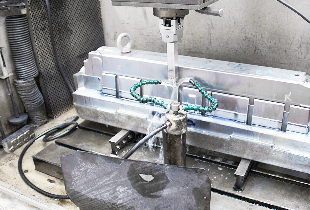 mold in EDM machine at MOLDIT Industries