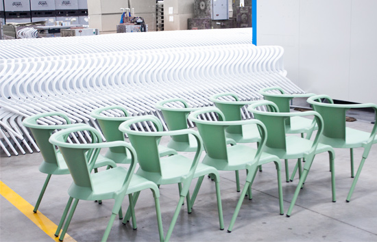 set of just injected green portuguese chairs arranged before being packed